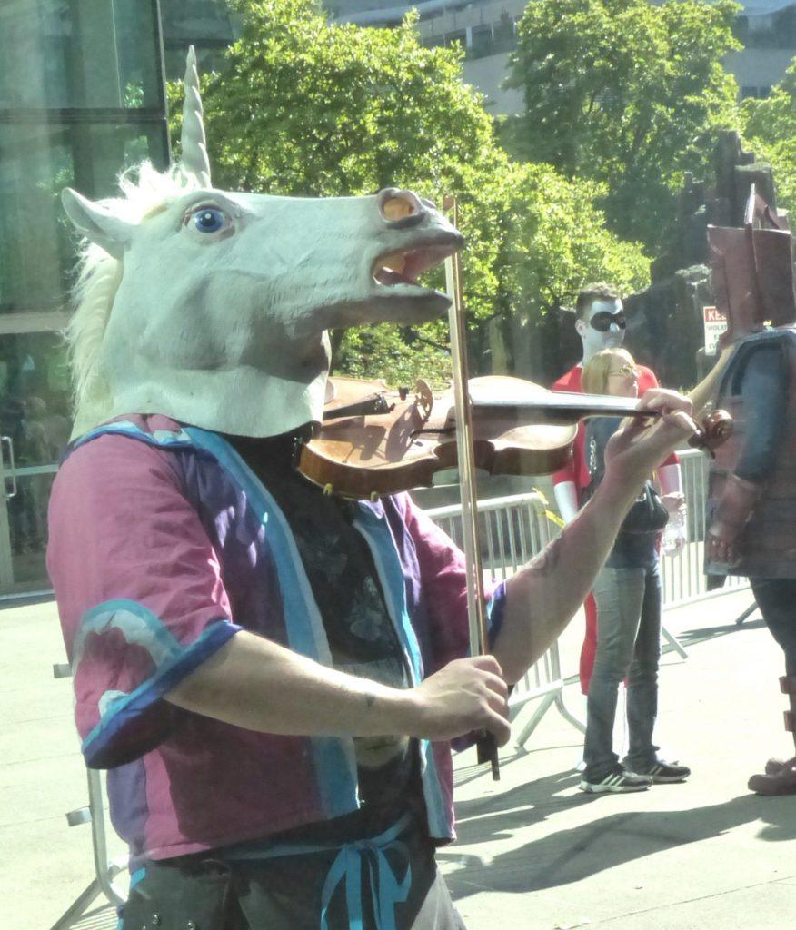 Unicorn playing a fiddle photo