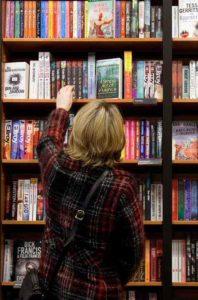 Reader selecting book photo