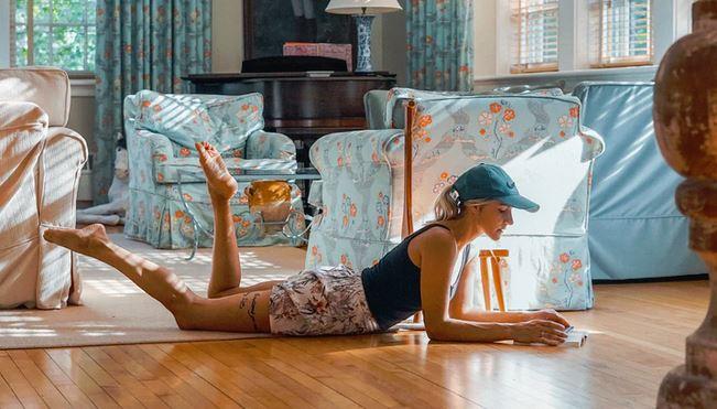 Woman reading on floor